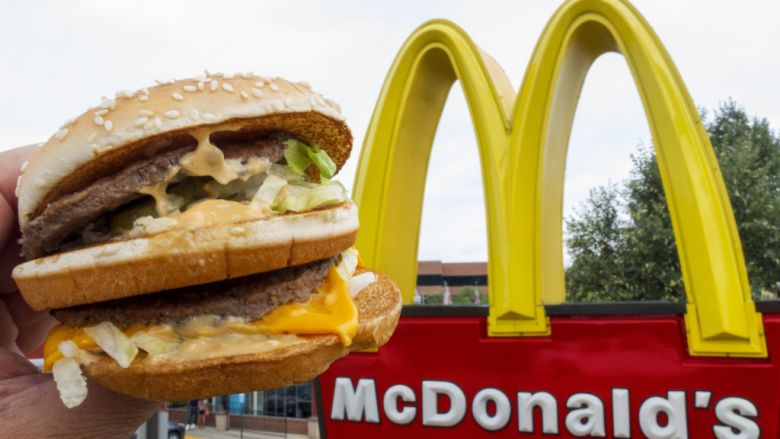 A McDonald's Big Mac, their signature sandwich is held up near the golden arches at a McDonalds's August 10, 2015, in Centreville, Virginia.      AFP PHOTO/PAUL J. RICHARDS        (Photo credit should read PAUL J. RICHARDS/AFP/Getty Images)