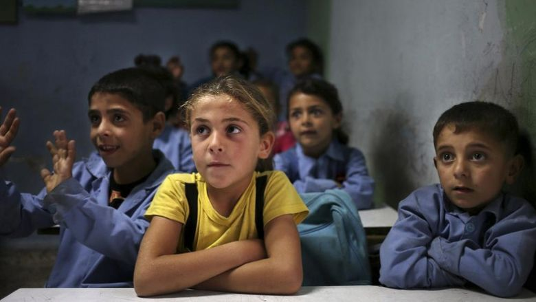 FILE - In this May 29, 2014 file photo, Syrian refugee students sit in their classroom at a Lebanese public school where only Syrian students attend classes in the afternoon in Kaitaa village in north Lebanon. The Lebanese government is launching a campaign to register 100,000 new students from among the Syrian refugee population in its already overwhelmed public schools. Education Minister Elias Bou Saab said this will give more refugee children a chance at free education. But he cautioned that nearly the same number of Syrian refugee children are still out of schools. (AP Photo/Hussein Malla, File)
