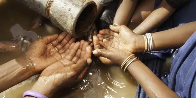 African Children Drinking Water