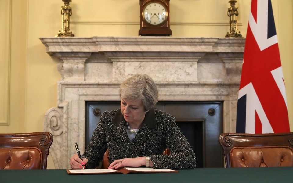 the-prime-minster-of-the-united-kingdom-theresa-may-signs-article-50-659167814-58dad27c22548